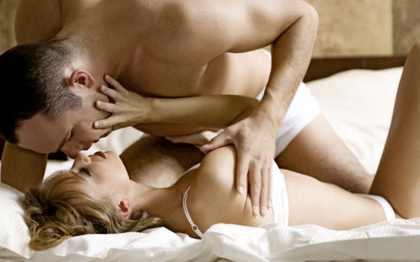 intimate young couple during foreplay in bed_sirabee