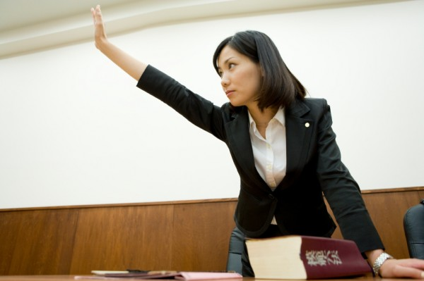 Lawyer raising hand