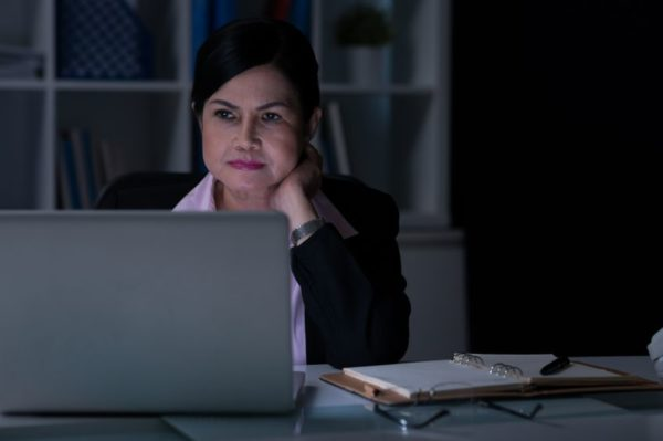 Businesswoman working in the office at night